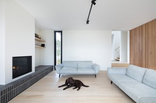 Tongue-and-groove Piccolo oak flooring is used throughout the home to create continuity between the existing house and the new extension. The gas fireplace is by Clean Face.