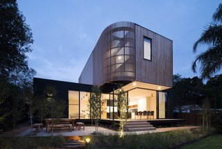 """""""To accommodate for the sloping site, the extension is terraced down the block with a slight change in levels between the original house, the entrance way, and the new modular living area,"""" adds the firm."""