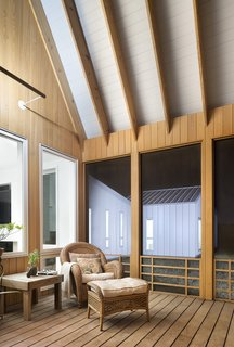 The enclosed screen porch is enveloped in locally sourced cypress.