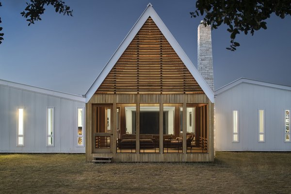 """The porch's distinctive 30-foot peak is discernible from a great distance, and its rhythmic, horizontal cypress slats are a contemporary interpretation of traditional vented gables,"" add the architects."