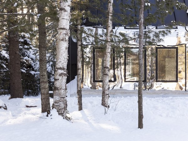 This Mirrored Cabin Playfully Brings a Forest Indoors