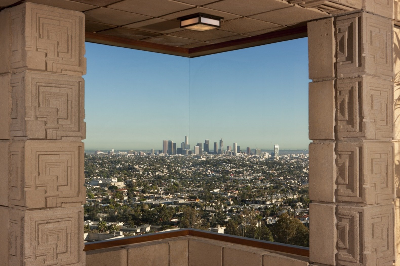 Windows and Wood One of three corner windows in the home frames panoramic views of the Los Angeles Basin.   Photo 14 of 23 in Frank Lloyd Wright's Iconic Ennis House Is Listed For $23M