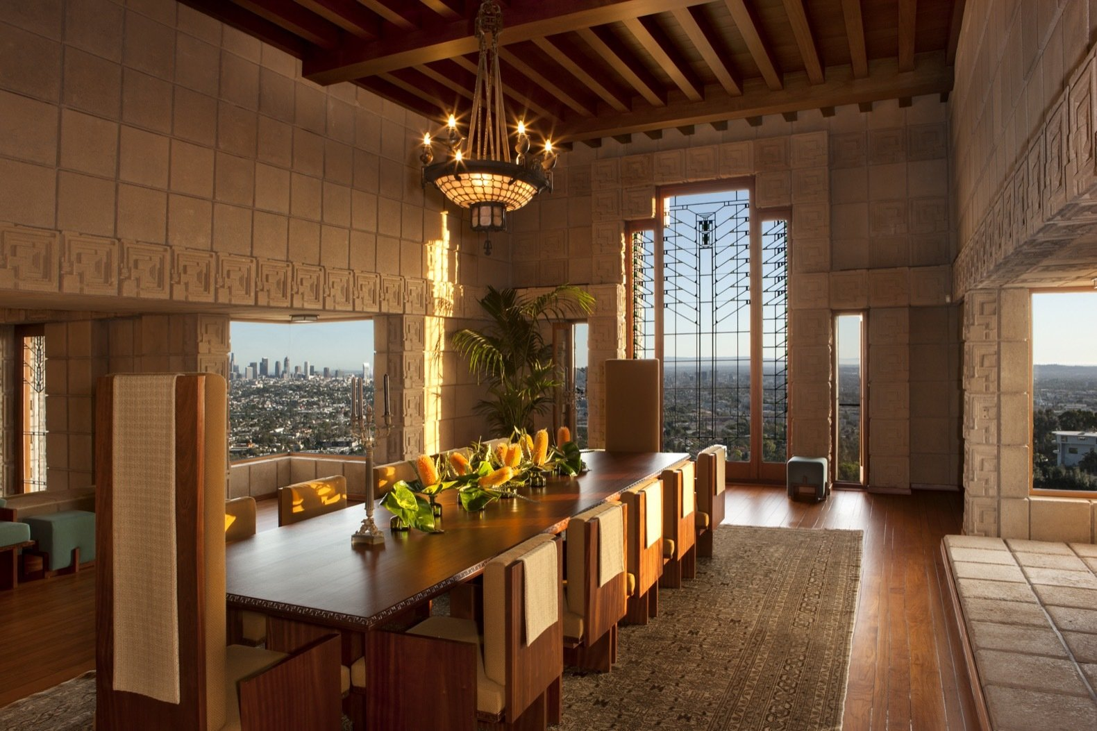 Dining Room, Table, Pendant Lighting, Medium Hardwood Floor, Chair, and Rug Floor Ample glazing sweeps the cinematic landscape into the dining room, the largest space in the house.  Photo 13 of 23 in Frank Lloyd Wright's Iconic Ennis House Is Listed For $23M
