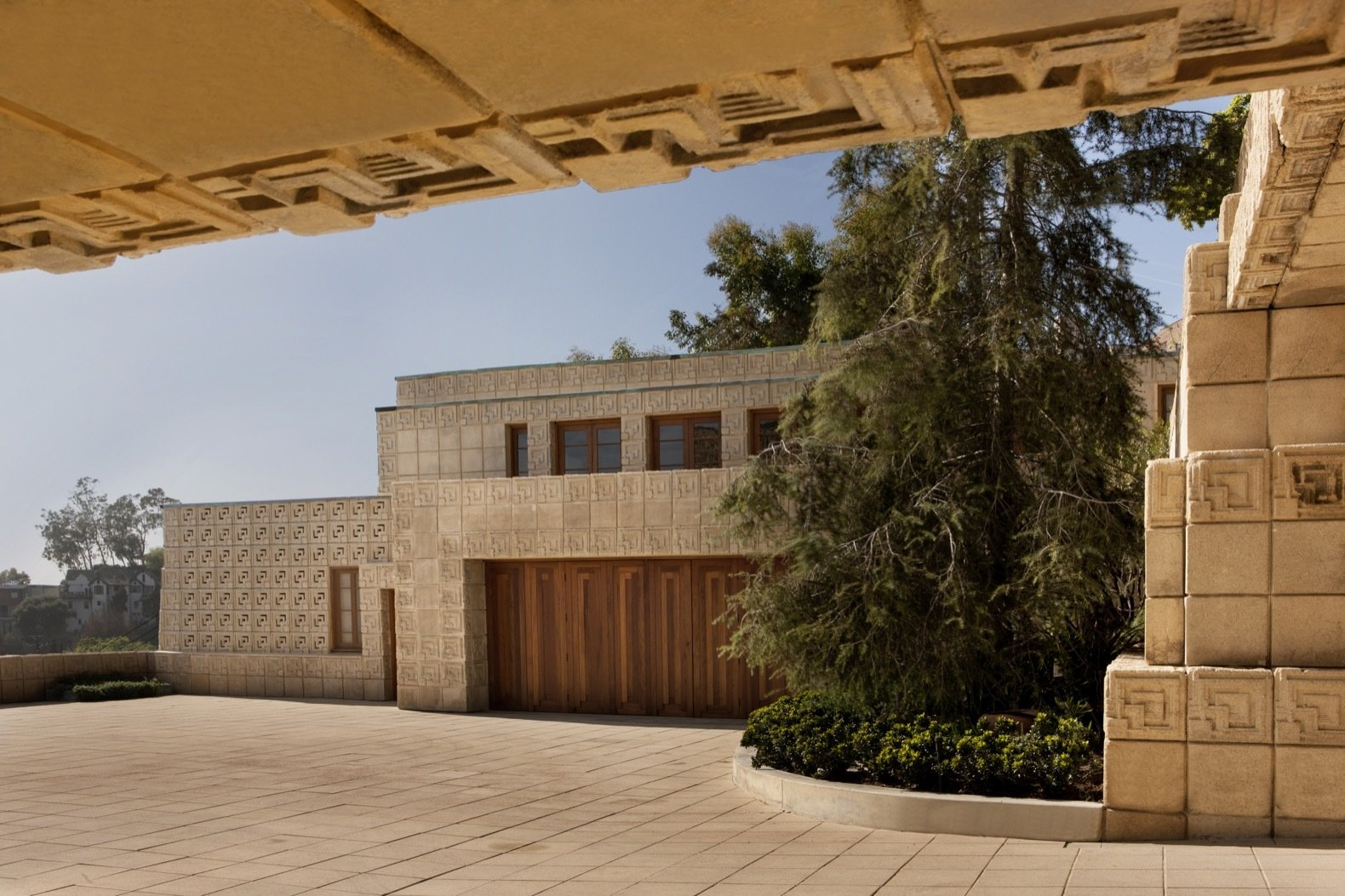 Exterior, Concrete Siding Material, and House Building Type A courtyard separates the main residence from the detached garage, and is topped with guest quarters, which was originally a chauffeur's apartment.    Photo 8 of 23 in Frank Lloyd Wright's Iconic Ennis House Is Listed For $23M