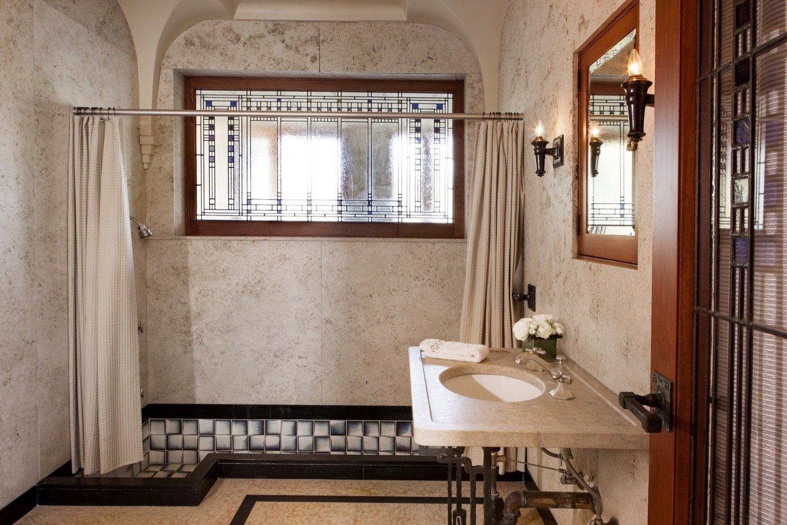Bath Room, Soaking Tub, Undermount Sink, Ceramic Tile Floor, Wall Lighting, Wall Mount Sink, and Full Shower A look inside one of the other bathrooms.   Photo 20 of 23 in Frank Lloyd Wright's Iconic Ennis House Is Listed For $23M