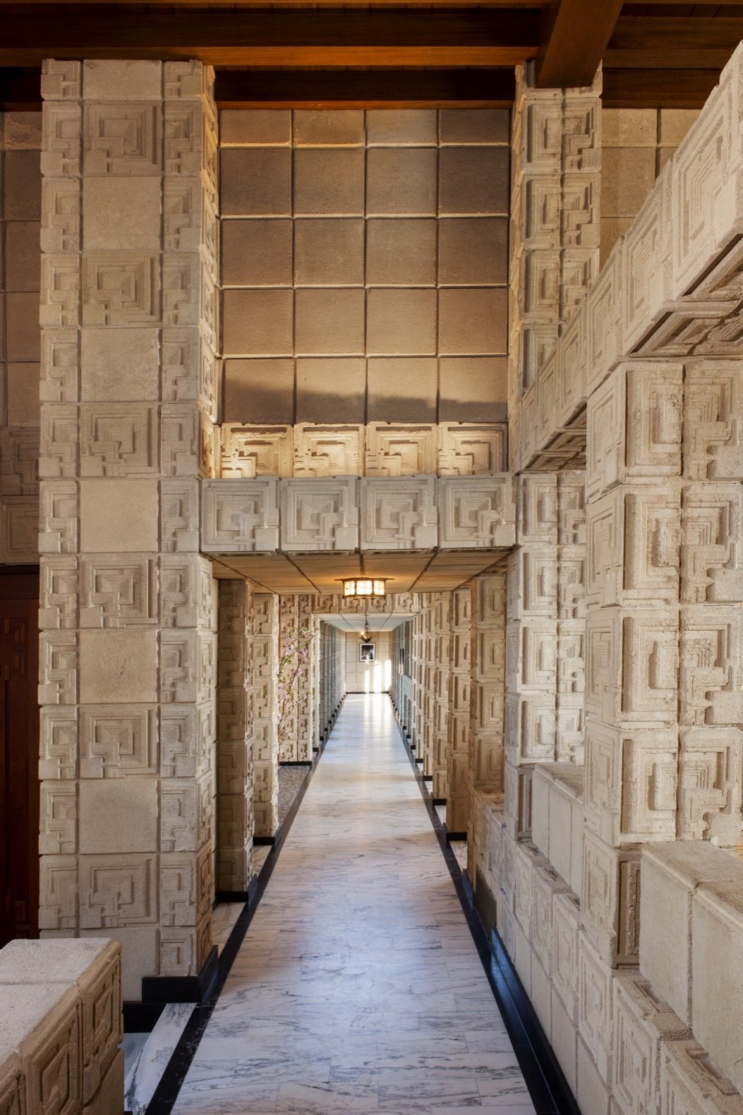 Hallway and Marble Floor A long, low-ceilinged loggia with marble floors leads to the master bedroom.   Photo 16 of 23 in Frank Lloyd Wright's Iconic Ennis House Is Listed For $23M