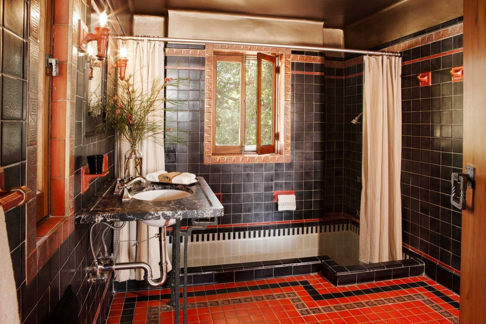 Bath Room, Ceramic Tile Wall, Undermount Sink, Soaking Tub, Wall Lighting, Stone Counter, Ceramic Tile Floor, Full Shower, and Wall Mount Sink Each of the bathrooms features a soaking tub and different patterned tile.  Photo 19 of 23 in Frank Lloyd Wright's Iconic Ennis House Is Listed For $23M