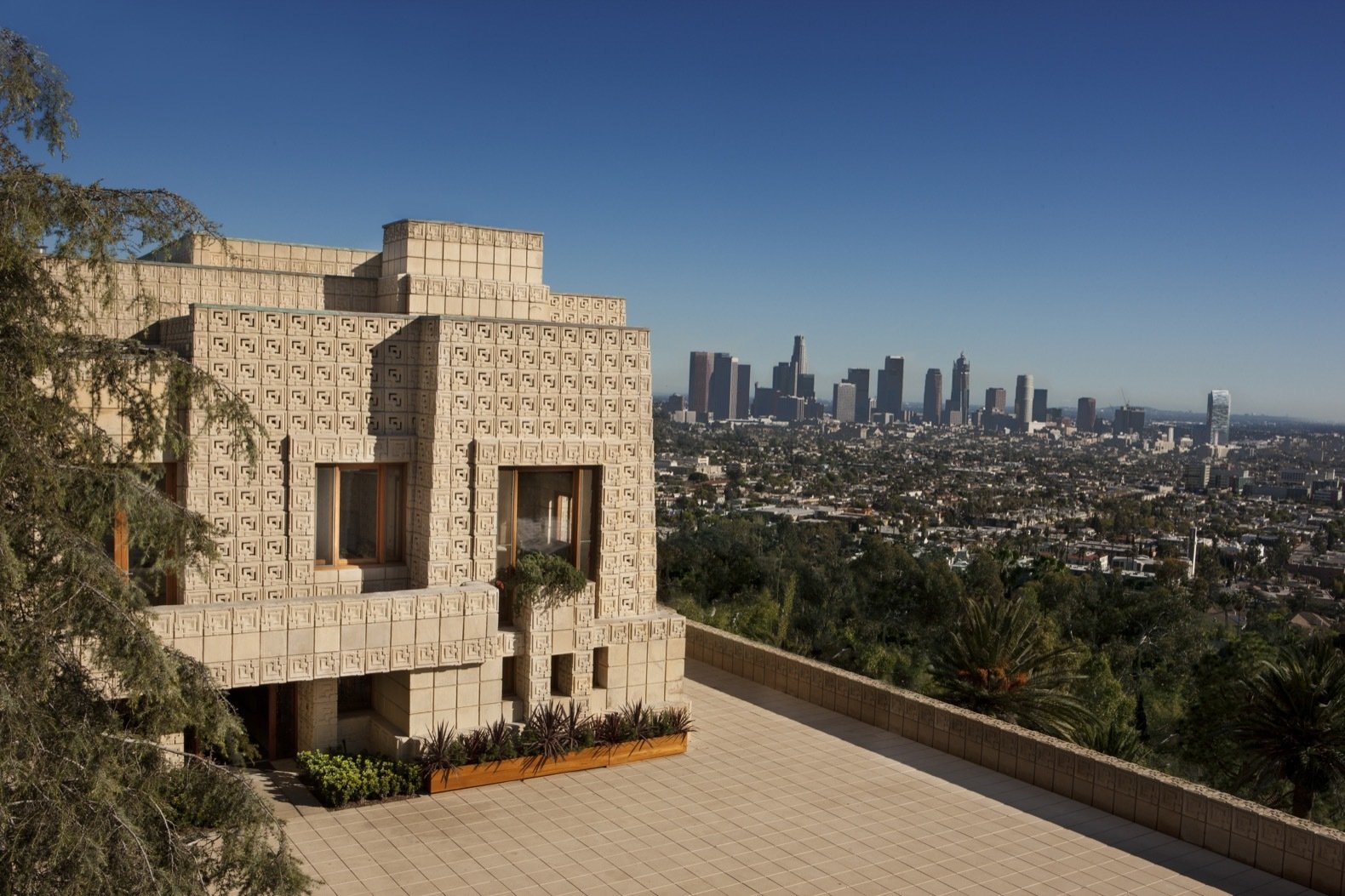 """Exterior, House Building Type, and Concrete Siding Material Set on a 0.3-acre hilltop, the Ennis House perfectly encapsulates Frank Lloyd Wright's famous quote: """"No house should ever be on a hill or on anything. It should be of the hill. Belonging to it. Hill and house should live together each the happier for the other.""""  Photo 1 of 23 in Frank Lloyd Wright's Iconic Ennis House Is Listed For $23M"""