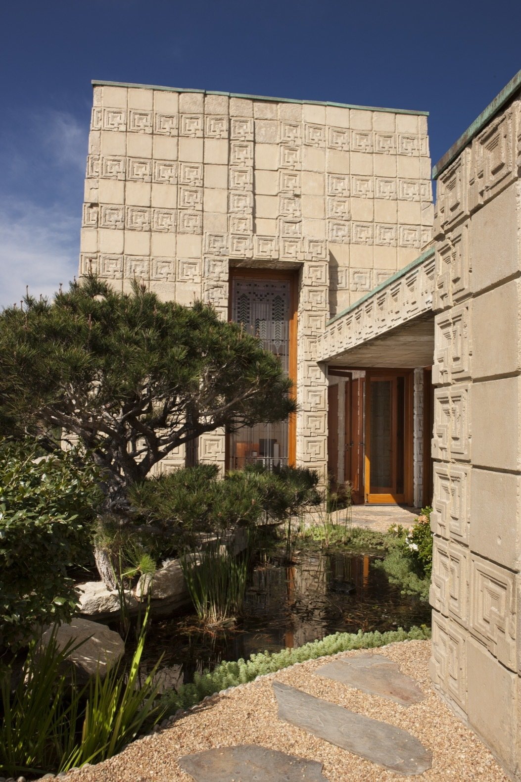 Exterior, House Building Type, and Concrete Siding Material A small koi pond and broad terrace can be found on the north side.   Photo 9 of 23 in Frank Lloyd Wright's Iconic Ennis House Is Listed For $23M