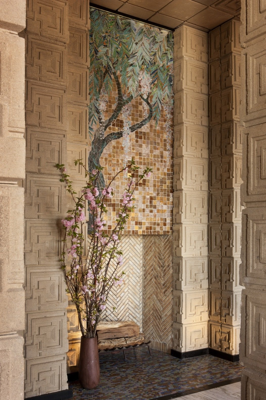 Living Room and Wood Burning Fireplace This stunning Wisteria glass-mosaic placed above the living room fireplace is one of only four of its kind ever designed by Wright, and is the only extant example.    Photo 5 of 23 in Frank Lloyd Wright's Iconic Ennis House Is Listed For $23M