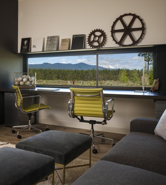 A low horizontal window is perfectly positioned in the office to frame views of the Cascade mountain range.
