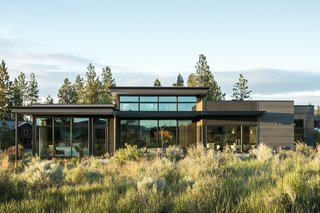 The timber-clad home's natural palette takes cues from the desert landscape.