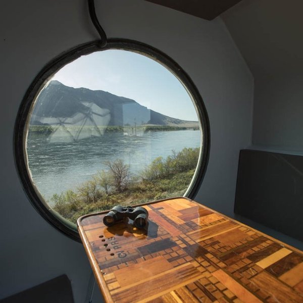 The acrylic porthole in the breakfast nook overlooks the Columbia River.