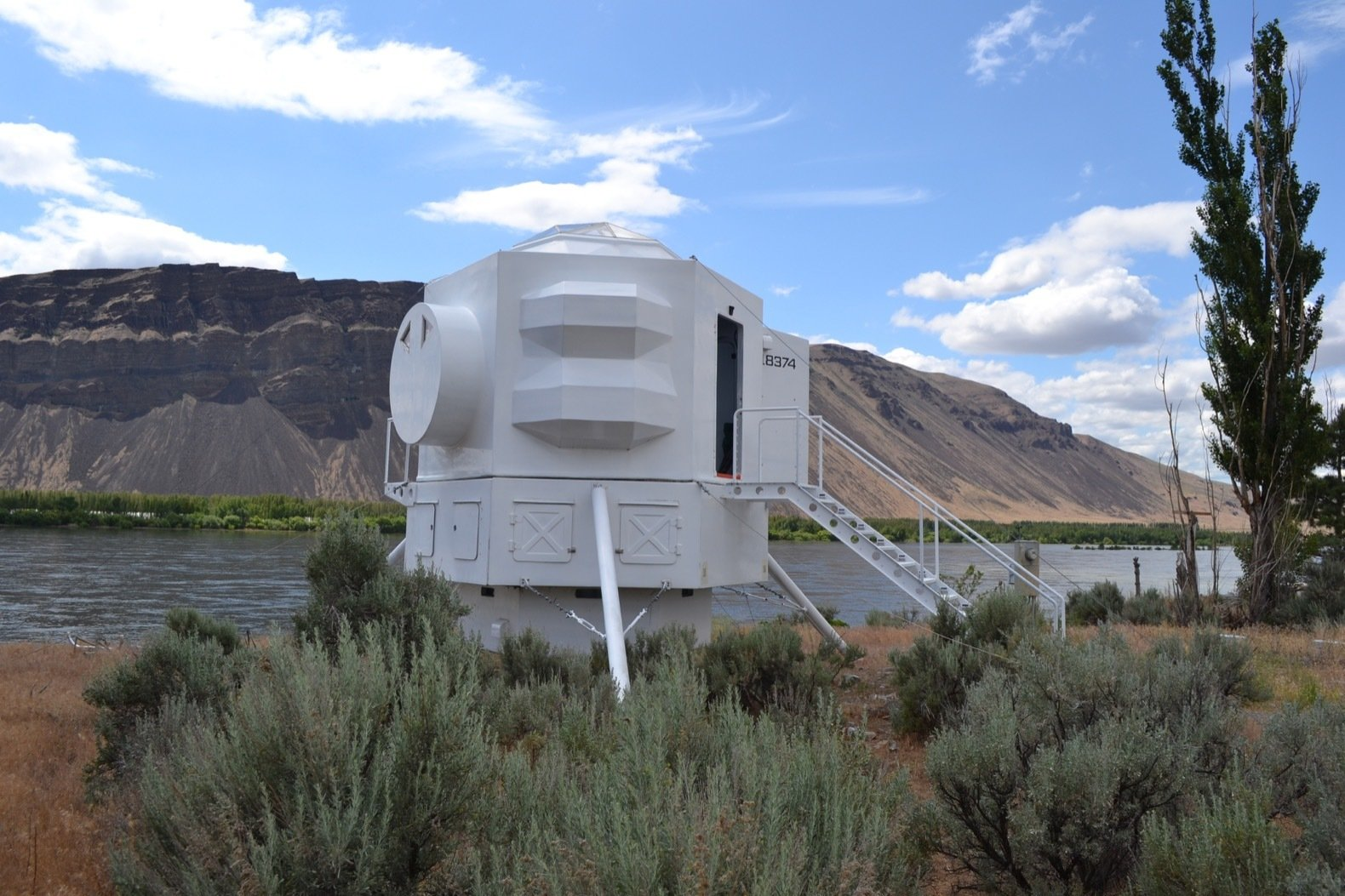 """Exterior, Dome RoofLine, and Tiny Home Building Type Utility equipment and storage is hidden in the hexagonal """"systems ring"""" below the living space modules.    Photos from A Lunar Lander-Inspired Tiny House is an Otherworldly Escape"""