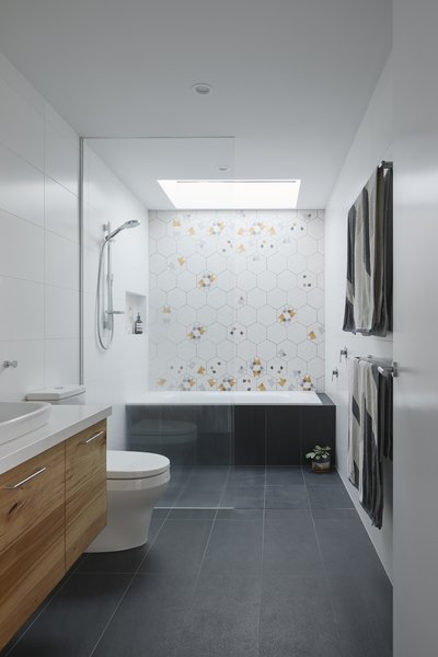 A strategically placed skylight bathes the shower area in natural light.