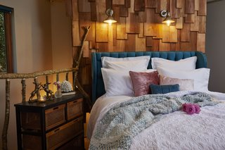 A Bolsover upholstered bed frame is set against a shingle accent wall fitted with Industrial 1 Light Armed sconces.