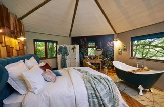 The domed master bedroom—which has a king-size bed—on the second floor provides an immersive experience in the treetop canopy thanks to the five large windows that punctuate the hexagonal space.