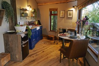 A look at the quaint kitchen and dining area. Complimentary staples are provided.
