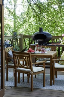A MORSØ wood-fired pizza oven sits beside a Marseille four-seater dining set.