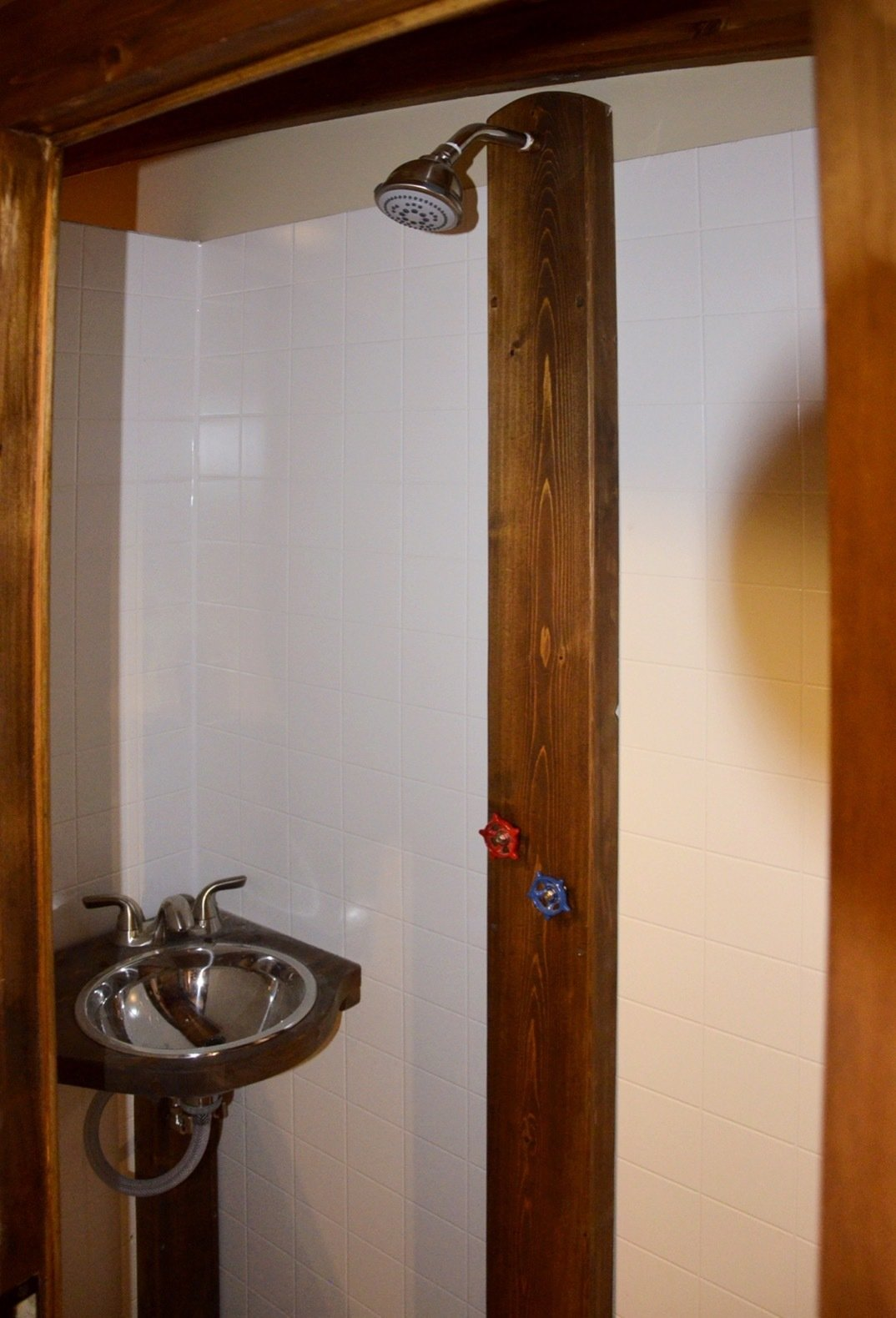 Bath Room, Open Shower, and Wall Mount Sink The full bathroom includes a toilet as well as a shower and sink that draws water from a 56-liter freshwater tank.  Photo 5 of 15 in Kick Back in This Tiny, Solar-Powered Houseboat For $61K