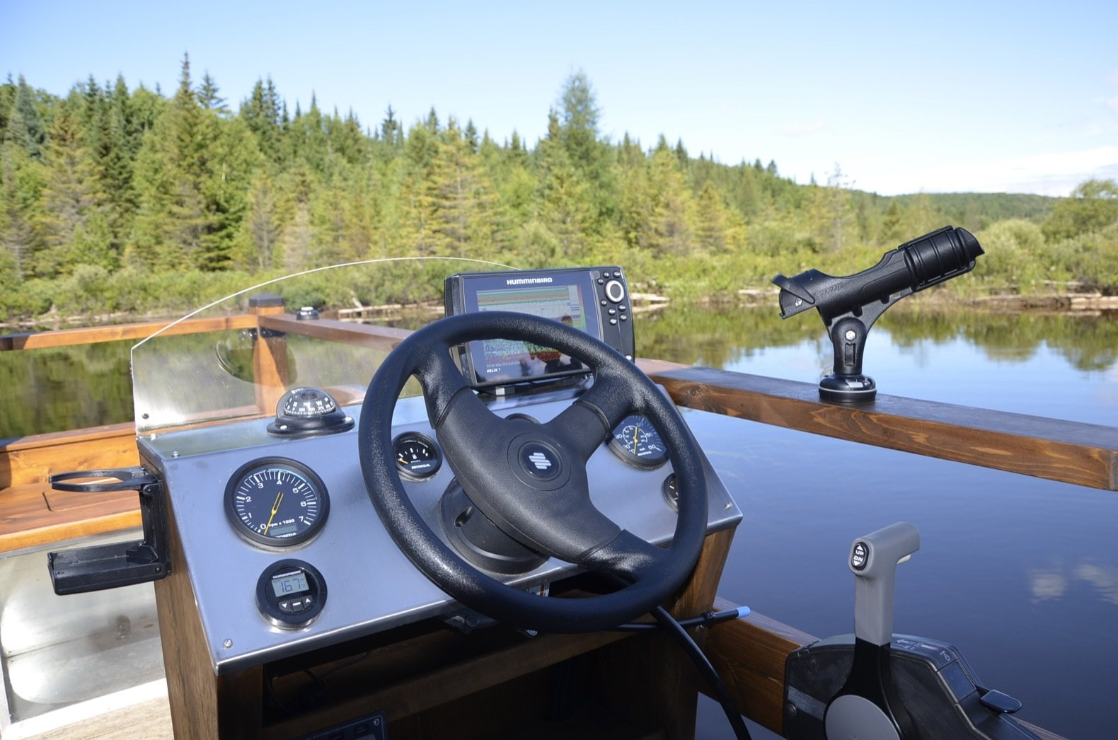 Outdoor, Wood Patio, Porch, Deck, and Small Patio, Porch, Deck The dashboard and instrument panel comes with sonar.  Photo 10 of 15 in Kick Back in This Tiny, Solar-Powered Houseboat For $61K