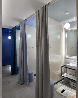 Once checked in, guests are encouraged to wind down in the lounge and use the bathrooms to change and prepare for sleep. The bathrooms are located opposite a row of lockers.