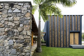 """The bamboo panels shade the façade, helping the thermal behavior of the building,"" add the architects."