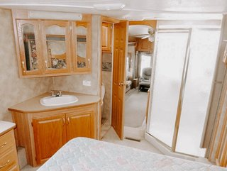 Here is a look at the original bathroom corner with its shiny wood paneling.