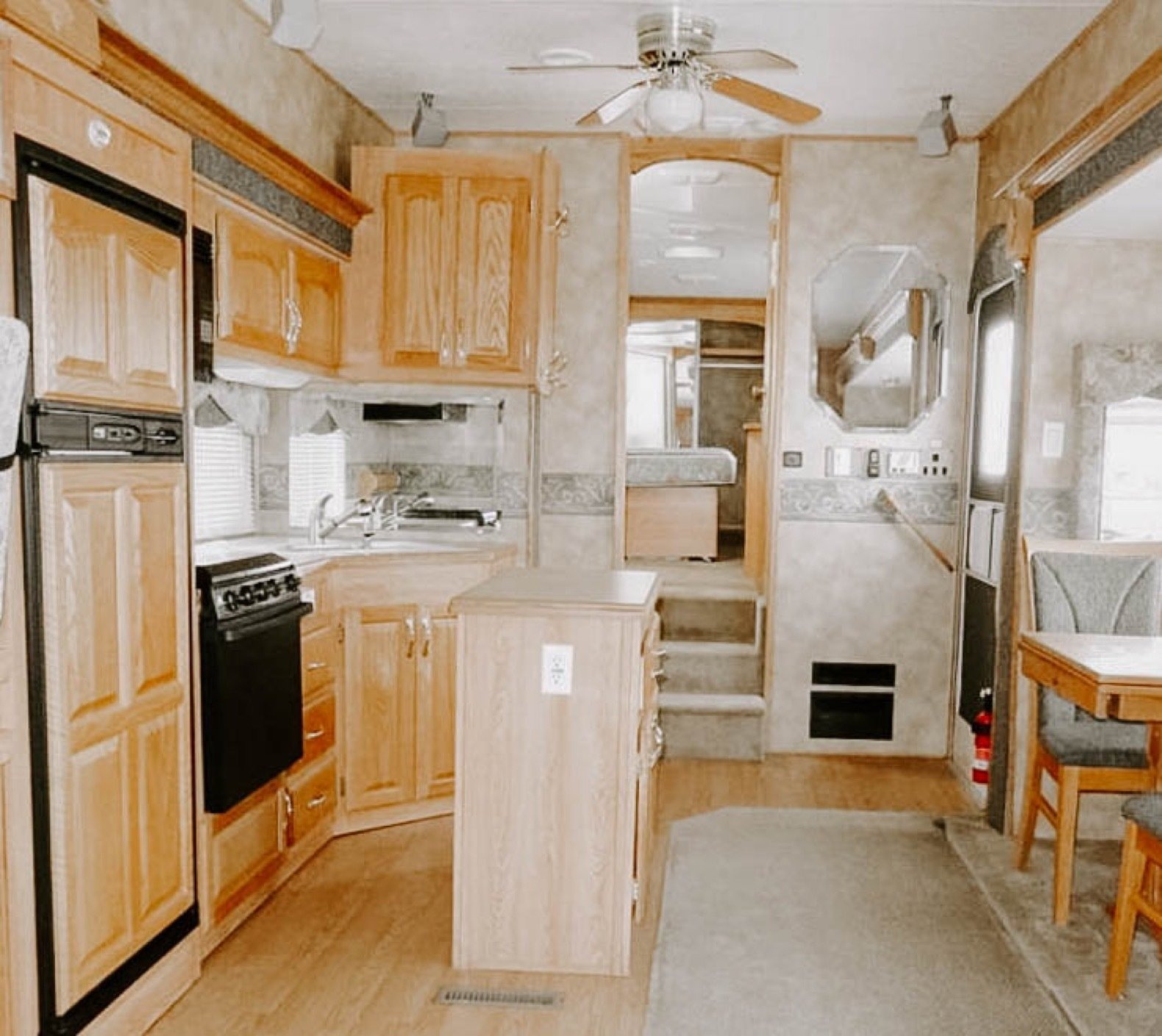 A look at the former kitchen leading to the bedroom in the rear.  Photo 5 of 25 in Before & After: An Uninspired RV Gets a Cheery Refresh For $5K