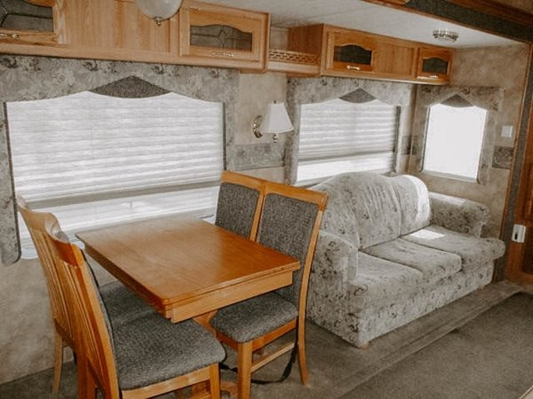 The original palette of the RV relied heavily on gray tones and wood.    Photo 13 of 25 in Before & After: An Uninspired RV Gets a Cheery Refresh For $5K