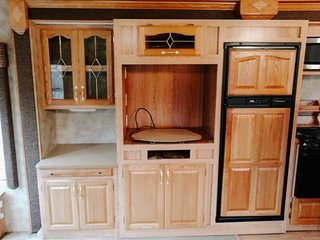 Because many of the cabinets were various sizes, the entertainment center felt extremely cluttered, even when it was empty.