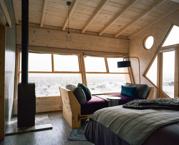 The beds face a large horizontal window that overlook views of the sea and the sunset.
