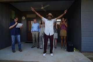 Buster and the student team celebrate the completion of the home at the ribbon cutting ceremony with neighbors and friends.