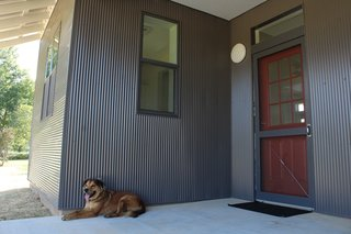 Buster's Home is a two bedroom, one-bathroom house with a generous living area, an<br>inset front porch, and a small bonus room.