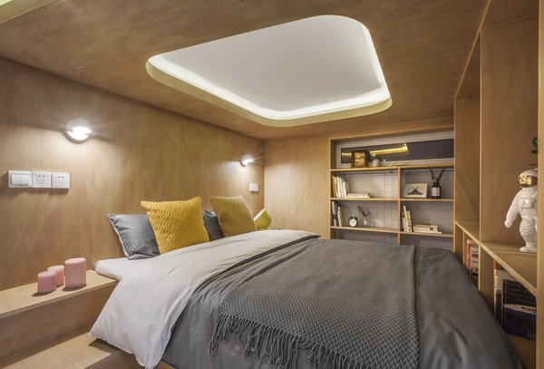 One of the most effective bedroom lighting ideas for a low ceiling is this recessed skylight-inspired lighting feature. It helps keep the space from feeling too snug.