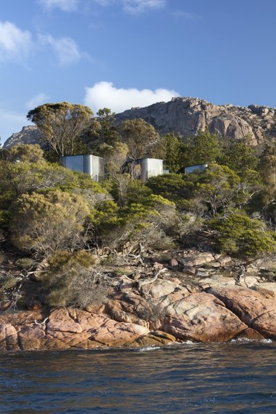 The nine pavilions are perched atop the beautiful, weathered pink granite of the Freycinet Peninsula.