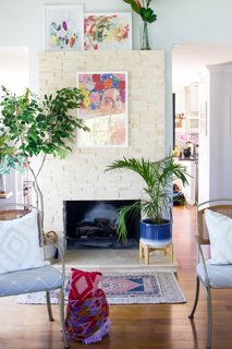 The fireplace in the sitting room was squared off and covered with stacked travertine.