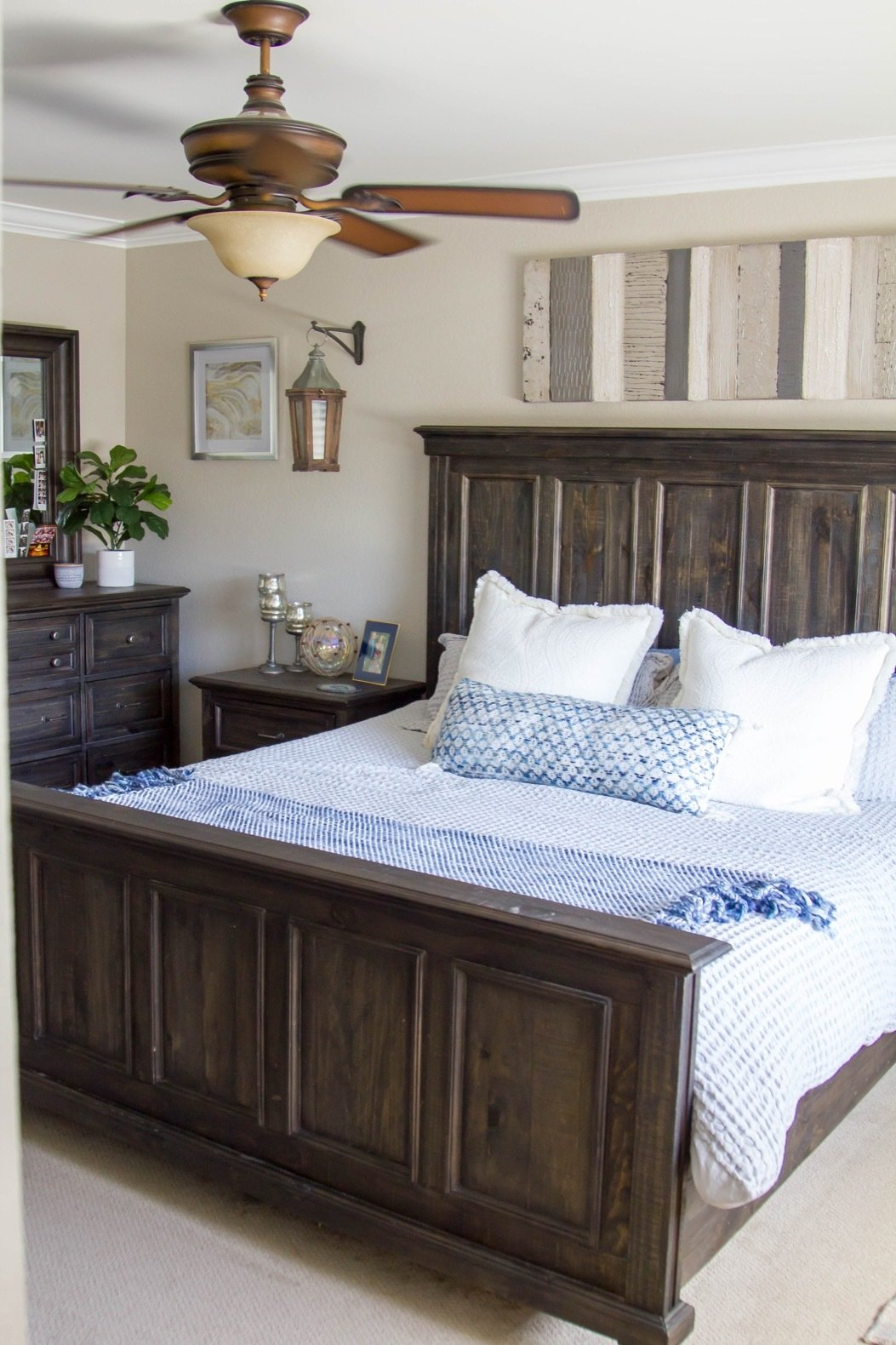 Bedroom, Night Stands, Ceiling Lighting, Dresser, Carpet Floor, and Bed The popcorn ceiling was replaced, textured, and painted while new base boards and crown moulding were put in. New paint, windows, and carpet modernize the room.  Best Photos from Budget Breakdown: A SoCal Couple Revamp Their Fixer-Upper For $63K