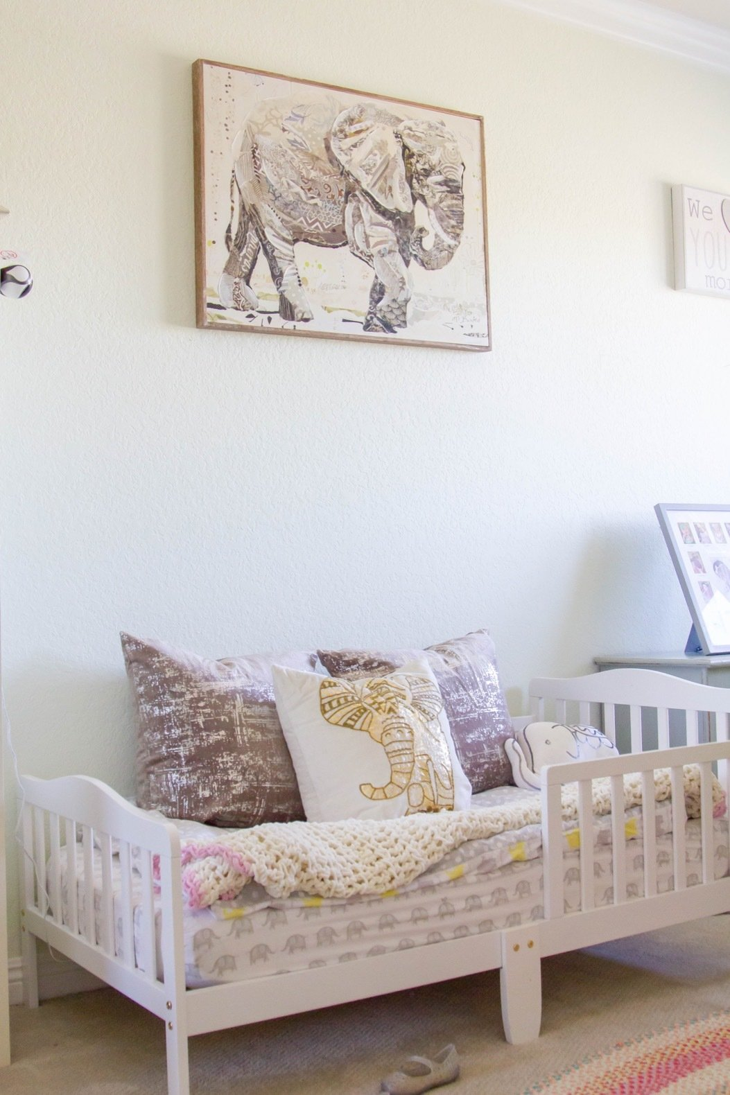 Kids, Rug, Bedroom, Toddler, Carpet, Bed, and Neutral Sienna's room has a clear elephant motif throughout.  Kids Neutral Rug Carpet Photos from Budget Breakdown: A SoCal Couple Revamp Their Fixer-Upper For $63K