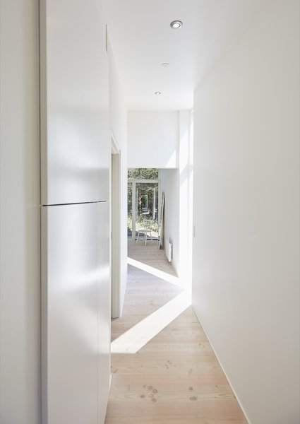 A hallway next to the kitchen leads to the master suite nestled on the east side of the main building.