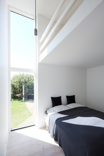 One of the bedrooms in the annex also features a loft with two additional beds for children.