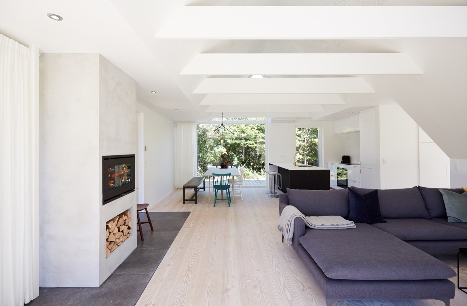 Living, Light Hardwood, Wood Burning, Chair, Table, Sectional, Stools, Pendant, Recessed, and Bench Modern Danish design has informed the minimalist interior, which is dressed in cozy fabrics and a muted natural palette.    Best Living Bench Stools Photos from Revel in Scandinavian Design at This Seaside Holiday Home
