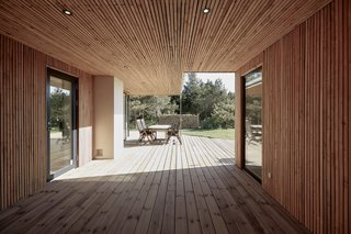 The surrounding forest served as a major design inspiration for the timber-clad home, which is oriented to face views of the trees.