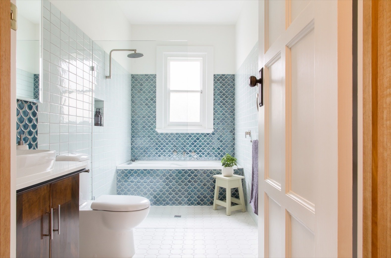 Bath, Vessel, Alcove, Open, Ceramic Tile, Stone, Porcelain Tile, and Two Piece The main bathroom was remodeled and enlarged. Instead of chrome, Megan opted for hardware with a soft pewter finish.   Bath Open Alcove Porcelain Tile Photos from A Cramped Bungalow Is Reborn as an Eco-Minded Abode For Two Gardeners