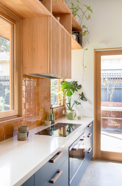 The compact, 54-square-foot kitchen is equipped with an induction cooktop (no gas used). The countertops are Create Stone's White Quartz made with 72-percent post-industrial waste.