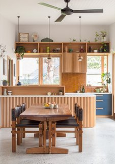 Double-glazed windows open the home up to the permaculture garden outside and northern sunlight. The kitchen is visible from nearly every room in the home.