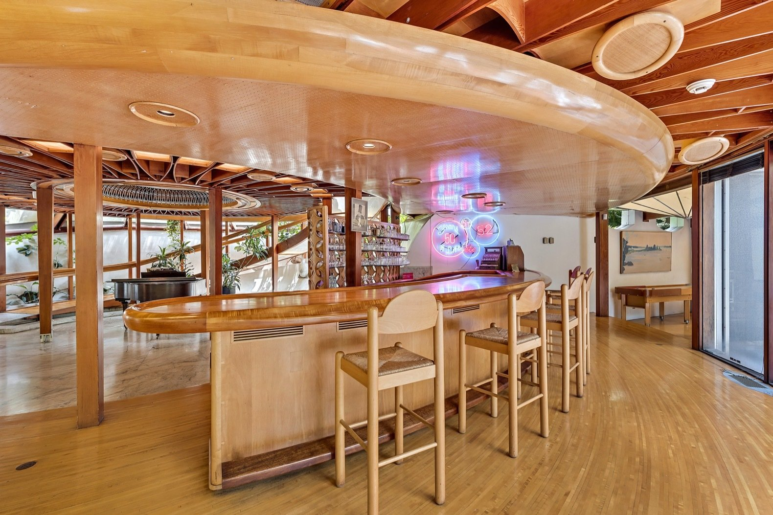Living, Medium Hardwood, Recessed, Bar, and Stools The property includes four bars—one of which seats 13 people.    Living Medium Hardwood Recessed Bar Photos from Jackie Gleason's Spaceship-Like Mansion Hits the Market For $12M