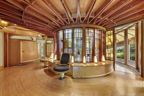 """Right angles were eschewed in favor of curved, organic forms. """"If you look at the ceilings, the woodwork looks like rowboats,"""" continue the agents. """"They are the trusses that hold the house up—there are no cross support beams, because they would have had right angles."""""""