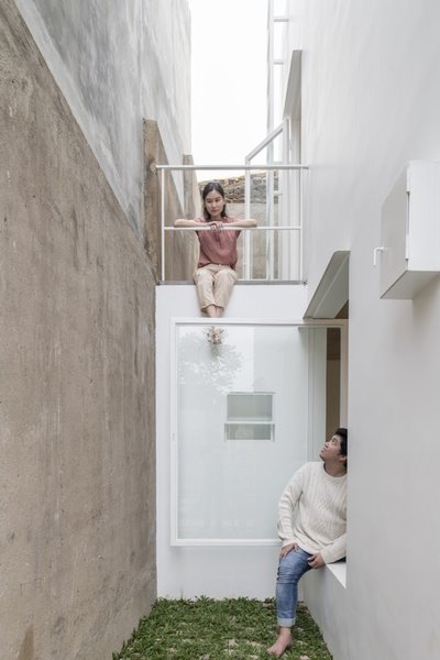 """Situation and activities outside are framed using various square windows that lead to different directions and views. This various openings allow unique interactions with neighbors and people passing by,"" the architects note."