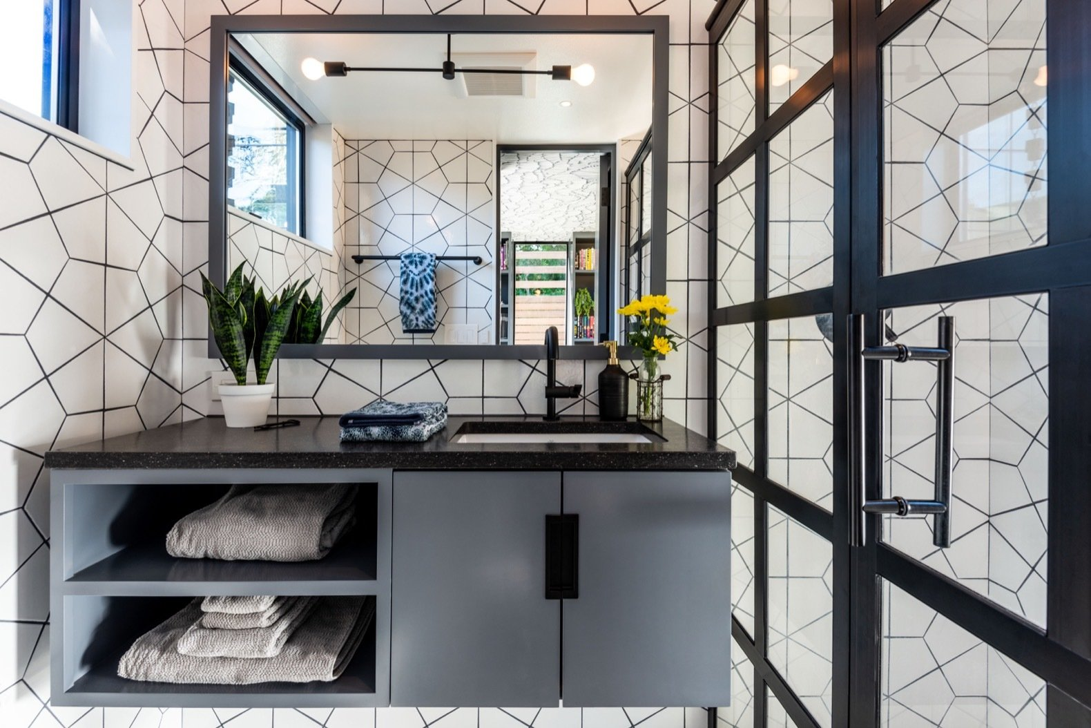 Bath, Engineered Quartz, Ceramic Tile, Ceramic Tile, Enclosed, Ceiling, and Undermount Fire Clay Hexite tile covers the bathroom walls. The countertop is Pental Quartz.    Bath Engineered Quartz Ceramic Tile Enclosed Photos from A Seattle Backyard Becomes a Calm Oasis For Two Book Lovers